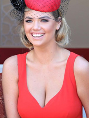Kate Upton classes up her red hot cleavage
