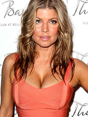Fergie busts out tanned birthday cleavage