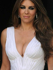 Elizabeth Hurley smoking hot cleavage in dress